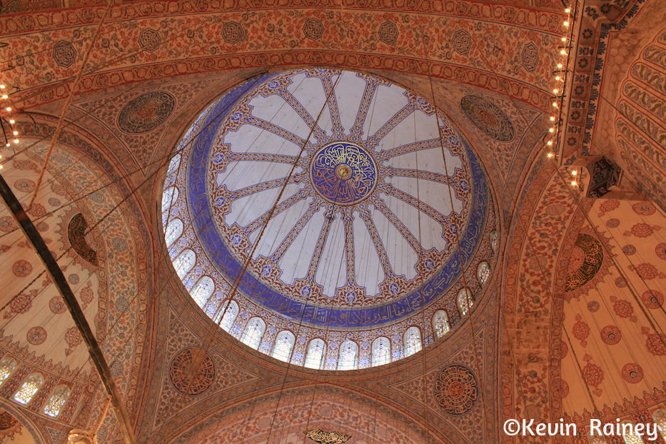 The grand interior dome of the Blue Mosque